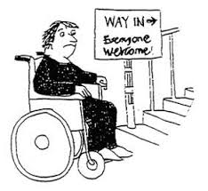 """person in a wheelchair in front of stairs with a sign that says """"way in. everyone welcome."""""""